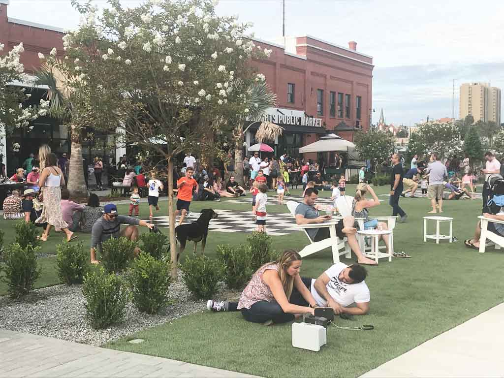 patrons enjoying the artificial grass lawn at Armature Works