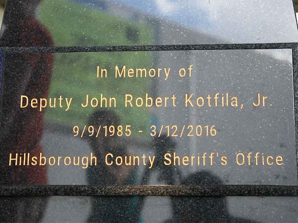 the sign commemorating Kotfila Memorial Dog Park in honor of fallen police officer John Kotfila