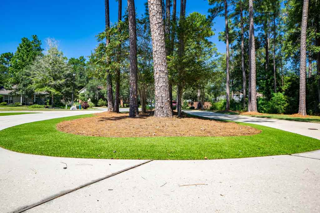Residential Artificial Grass Landscape with trees in the center of a circle